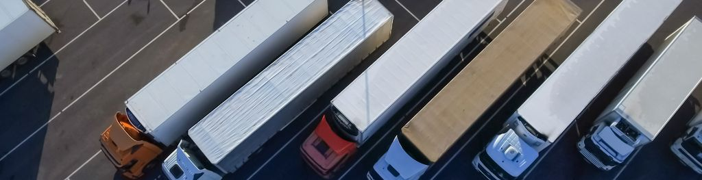 Six deliveries lorries in parking bays, viewed from above