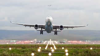 A plane taking off from an airport runway.