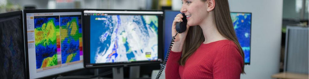 A meteorologist from the Met Office providing a specialist forecast for a customer on the phone.