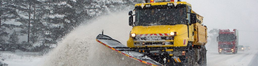 Gritter lorry in snow ploughing snow ahead of itself