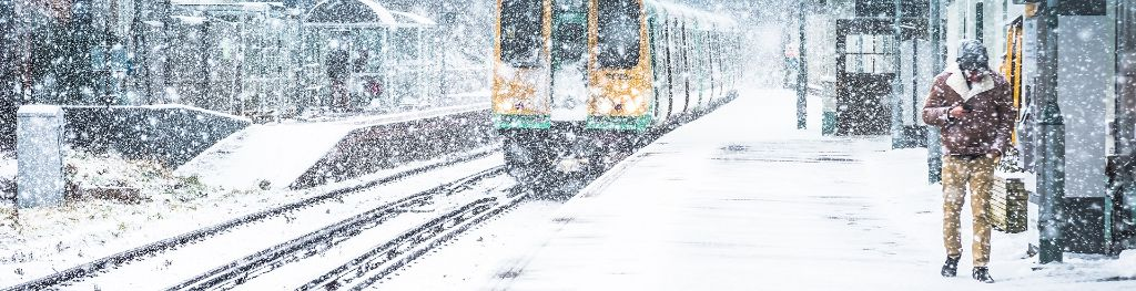 Train travelling in heavy snow
