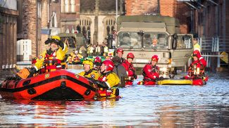 Emergency rescue team in action in a flooded town.